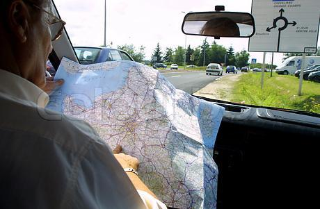 man-reading-map-in-car
